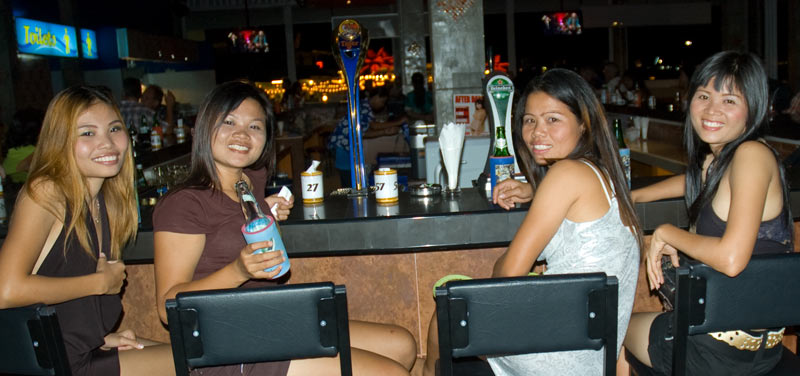 A beer bar on Sukhumvit road you can take ladies out...